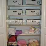 "I use canvas storage bins (with cedar inserts for freshness) to hold clothes not in use. Each child has a ""now"" and a ""next"" container."
