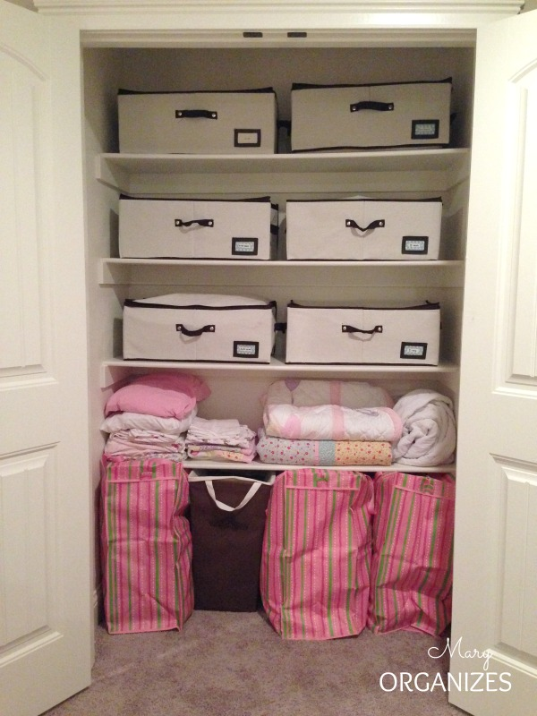 Quick fix closet organizing for blanket pillow storage for Living room blanket storage ideas